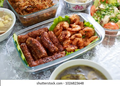 Deep Fried Prawns and Five-Spice Meat Rolls with other dishes served during chinese new year reunion dinner