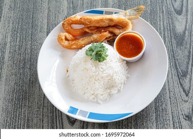 Deep fried salmon bellies or crispy salmon belly and spicy sauce with rice.
