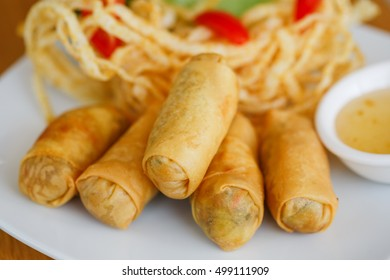 deep fried spring rolls on white dish