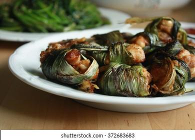 Deep fried Thai chicken wrapped in pandan leaves