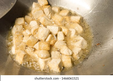 deep fried tofus with boiling oil in the pan