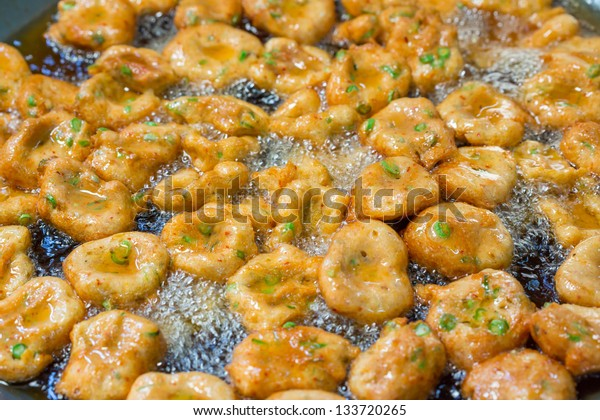 Deep frying fish cake for sale in market