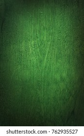 Deep green wood texture background