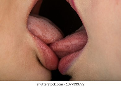 Deep kiss. Female lips close-up. Love and feelings. Lesbian love. Sensual kiss. Homosexual partner. Women's weasel. Gentle tongue in the female mouth.