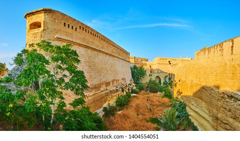 The deep moat in front of the bastions and ramparts of medieval Fort St Elmo, Valletta, Malta