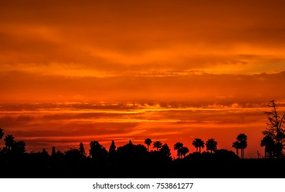 Deep orange sky as the sun sets over the city of Marrakech in Morocco