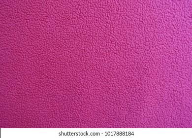 Deep pink polar fleece fabric from above