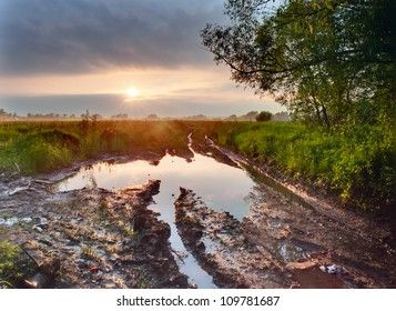 Deep puddle on a dirty road