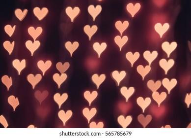Deep red heart bokeh background. Modern flat design for card or website.