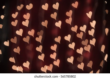 Deep red heart bokeh background. Modern, angled flat design for card or website.