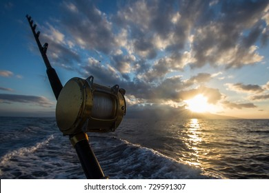 Deep Sea Fishing Reel on a boat during sunrise