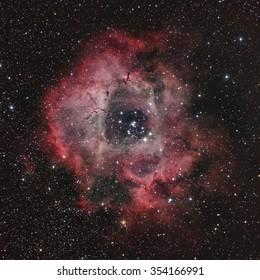 Deep Sky Astronomy Object in the Night Sky - Rosette Nebula through a telescope