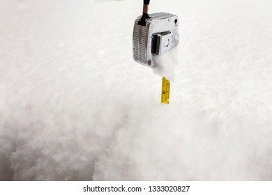 Deep snow, 9 inches with measuring tape showing the depth