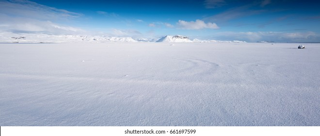 Deep snow covered landscape, mountain and blue sky by day, Iceland, Europe. Iceland nature 2017 winter cold