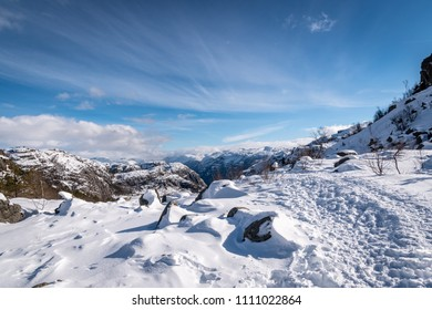 Deep snow hiking Preikestolen sunny