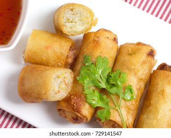 Deep spring rolls on white plate.Top view