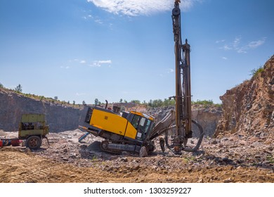 Deep surface drill rig in a quarry open pit mining of granite stone. Process production stone and gravel. Quarry mining equipment. Preparation for blasting.
