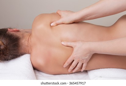 Deep tissue massage on the woman's back