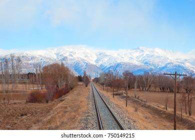 Deep Winter Train Tracks and Mountains