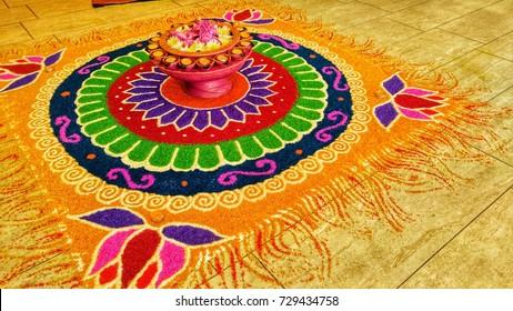 Deepavali Kolam or Rangoli decoration on marble during festival.