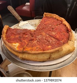 Deep-dise pizza on the table, signature Chicago style