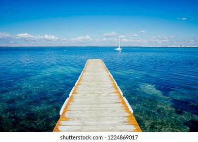 LakeDonuzlav , the deepest lake of Crimea. Small white boat sailing on the lake.  Donuzlav Bay landscape in  Crimea