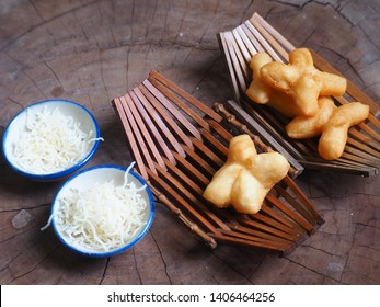 deep-fried dough stick in a basket of brown weave and coconut candy