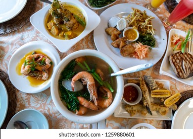 Deep-fried eggplant, Tuna Steak and Steamed Shrimp dishes on the table, Philippines