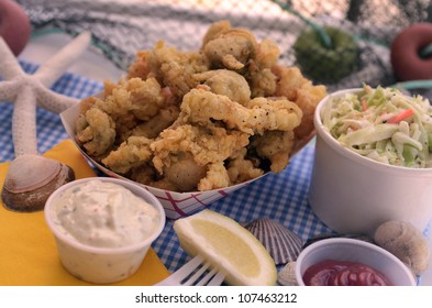 Deep-fried whole bellied clams with a side order of coleslaw