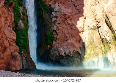 Deer Creek Falls inside of the Grand Canyon near Colorado River mile 137, that plunges over 150 feet from Deer Creek and flows into the Colorado River