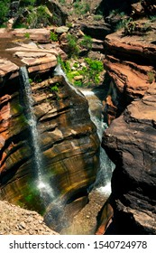 """Deer Creek inside of the Grand Canyon, falls into the """"Deer Creek Narrows"""" that cascade down the infamous """"patio"""" of Tapeats Sandstone"""