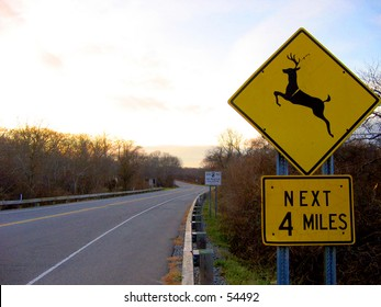 Deer Crossing Next 4 Miles Sign