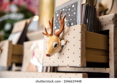 Deer hand grip on bookshelf
