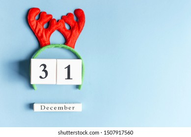 Deer horns with cubes with a festive date on December 31.