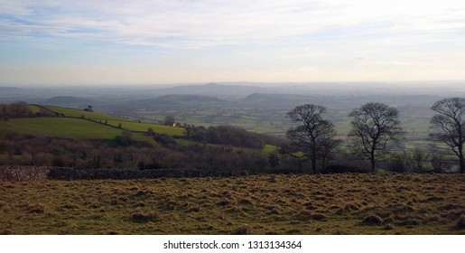 Deer Leap near Ebbor Gorge in Somerset, showing the winter afternoon view looking towards Glastonbury Tor.