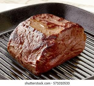 Deer meat steak on frying pan