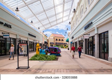DEER PARK, NY - JULY 22, 2015: View of Tanger Factory Outlet outdoor shopping mall on Long Island, NY