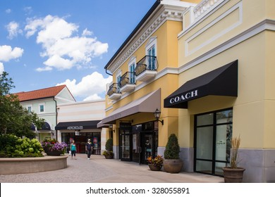 DEER PARK, NY - JULY 22, 2015: View of Tanger Factory Outlet outdoor shopping mall on Long Island, NY near the Coach Store