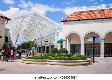 DEER PARK, NY - JULY 22, 2015: View of Tanger Factory Outlet outdoor shopping mall on Long Island, NY near the Calvin Klein Store