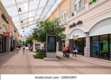 DEER PARK, NY - JULY 22, 2015: View of Tanger Factory Outlet outdoor shopping mall on Long Island, NY near the Stride Rite shoe store
