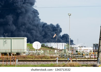 Deer Park, Texas / United States - March 19, 2019: Multiple tanks burn at Deer Park chemical facility. A massive plume of black smoke hangs over Houston