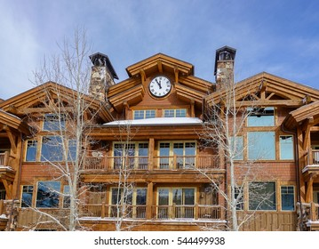 Deer Valley, Utah, USA - December 19, 2016: A ski lodge at Deer Valley Ski Resort, adjacent to a ski lift, with a large clock prominently displayed. on a partly cloudy winter day..