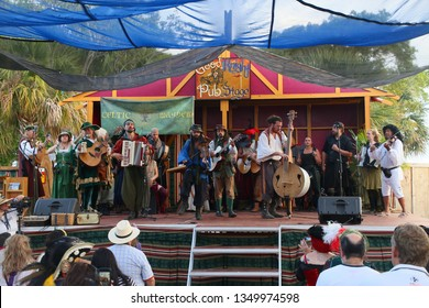 DEERFIELD BEACH, FLORIDA / USA - MARCH 9 2019:  The Celtic Mayhem Irish band performs on the Good Knight Pub Stage late in the afternoon near sunset at the South Florida Renaissance Festival.