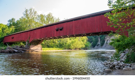 Deer's Mill Covered Bridge crossing the Sugar Creek in Montgomery County, Indiana. At a length of 275 feet, the Burr arch-truss construction features 2 arches. It was built in 1878 by Joseph J Daniels