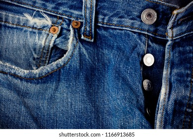 defective jeans background denimand and  silver button jeans  with a seam of vintage fashion design denim texture