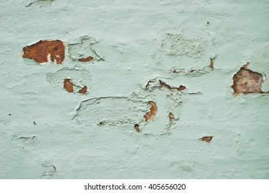 Defective paint on a brick wall