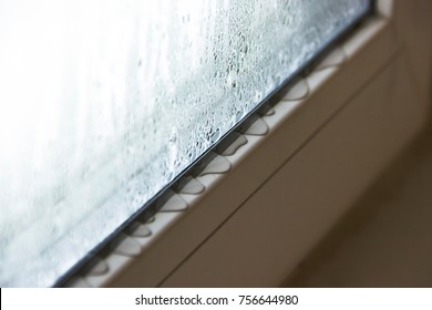Defective plastic window with condensation