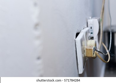 Defects mounting socket plug for wire internet or LAN cables.