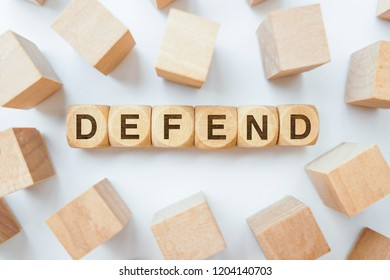 Defend word on wooden cubes