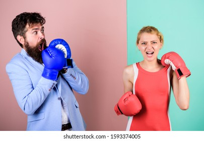 Defend your opinion in confrontation. knockout punching. win the fight. Strength and power. problems in relationship. sport. bearded man hipster fighting with woman. family couple boxing gloves.